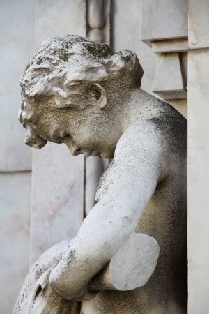 Sad boy angel old stone sculpture  Cemetery Recoleta  photo
