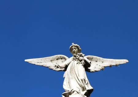 Guardian angel stone statue Light belief symbol  photo