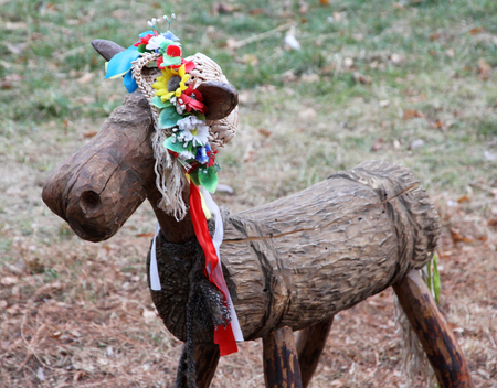 Wooden Ukrainian bull-calf in a flower wreath.