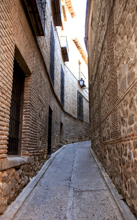 Lonely narrow old street. Toledo, Spain travel.
