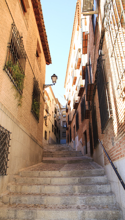 Toledo narrow street with a ladder. Travel Spain. Stock Photo