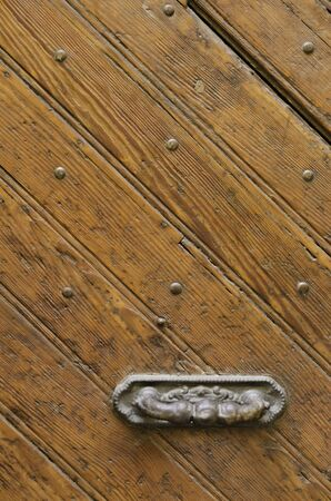 knob: Wooden door and knob.
