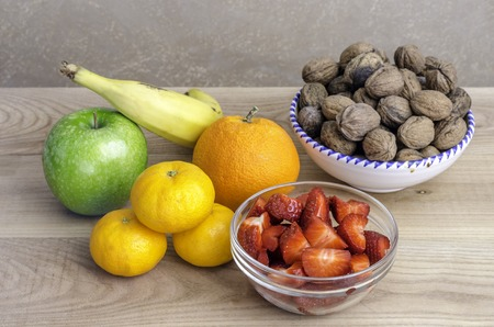 apple orange: Set of fruits banana apple orange tangerines walnuts Stock Photo
