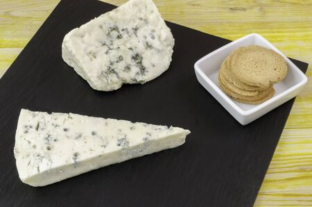 rips: Gornozola Roquefort and bread over slate plate.