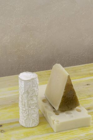 gruyere: Spanish Manchego cheese goat cheese and gruyere over wood. Stock Photo