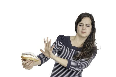 refuse: Portrait of young attractive woman refuse a cream cake.