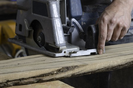 mitre: Male carpenter is cutting wood. Stock Photo