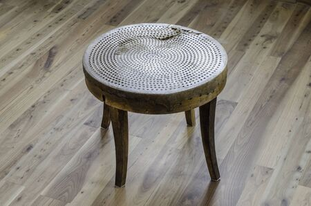 sift: Table made hand with old sieve over wood.