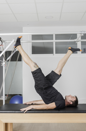 aerobic instructor: Pilates aerobic instructor man in cadillac fitness exercise Stock Photo