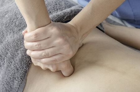Physiotherapist doing a massage girl back. Manual technic. Deep muscle.