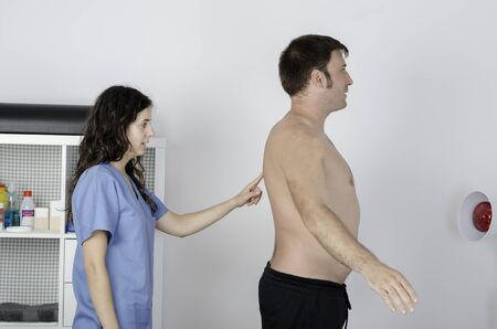explored: Physiotherapist doing a visual exploring, static dinamic positition, man patient.