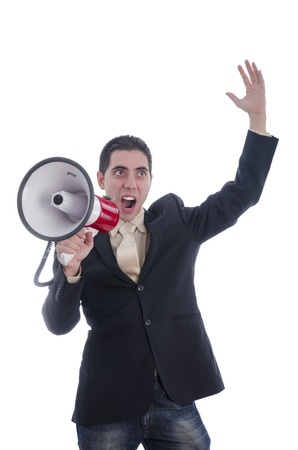 loud hailer: Man dressed in suit and tie shouting with flushed face through megaphone over white background.