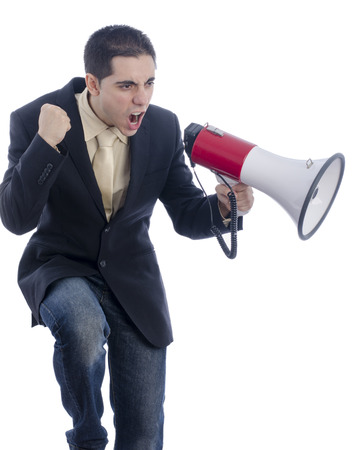 loud hailer: Man dressed in suit and tie shouting through megaphone over white background.