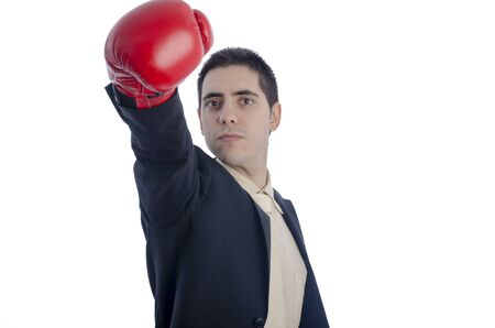 arm extended: Man in suit with red boxing gloves his arm extended to the front over white background.