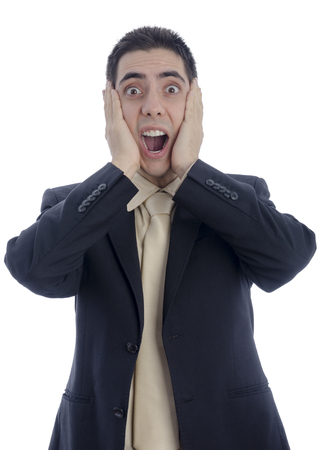 desperation: Man in business suit with his hands on his face shouting in desperation over white background.