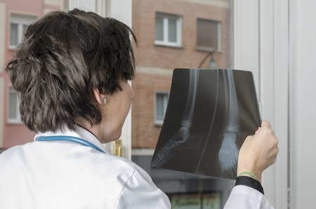 examination room: Female doctor looking a x-ray in examination room.