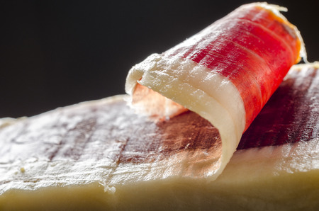 Detail of sliced iberian spanish, bellota ham. Gourmet spanish food. Stock Photo