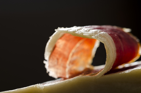 rich flavor: Detail of sliced iberian spanish, bellota ham. Gourmet spanish food. Stock Photo
