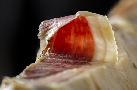 iberian: Detail of sliced iberian spanish, bellota ham. Gourmet spanish food. Stock Photo