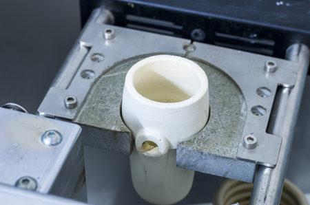 metal casting: Centrifugal casting machine to molten metal in a lab. Stock Photo