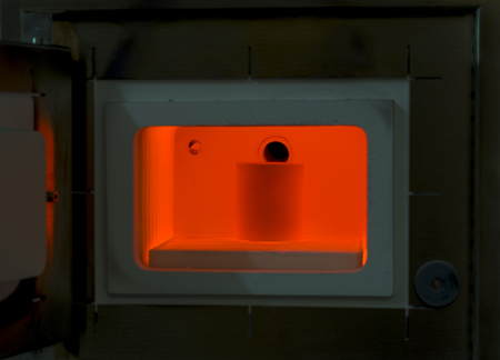 molten: Red hot furnace for all kinds of casting molds. Molten metal. Stock Photo