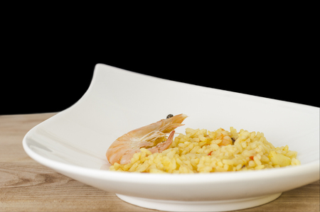 fish oil: Paella with seafood, typical Spanish dish on white background.