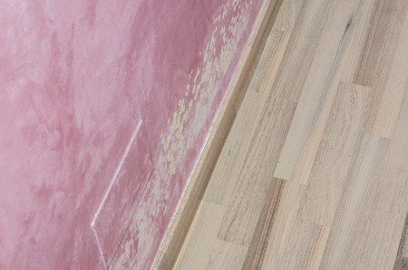 dankness: Mold and moisture buildup on pink wall of a modern house. Stock Photo