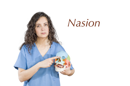 conjunction: Physiotherapydoctor pointing to a conjunction of suture in a skull and name Nasion.