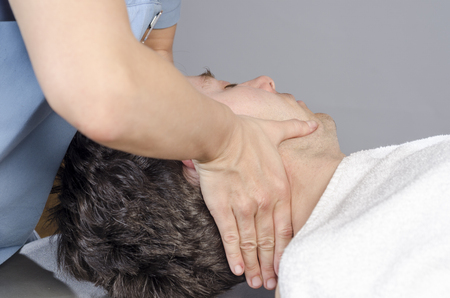 myofascial: Physiotherapist is doing manipulation cervical to a man patient