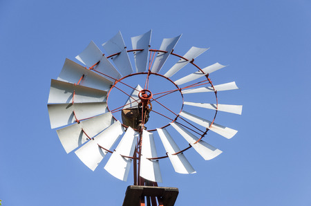 Old antique Aermotor windmill used to pump water and beautiful blue sky.