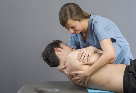 spinal manipulation: Physiotherapist doing manipulation to man patient. Osteopathy. Stock Photo