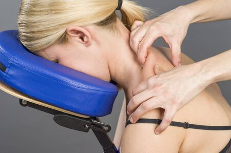 posture correction: Doctor, physiotherapist examining her patient back and doing decontracting massage.