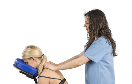 postural integration: Doctor, physiotherapist examining her patient back and doing decontracting massage.