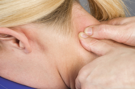 muscle retraining: Doctor, physiotherapist examining her patient back and doing decontracting massage.