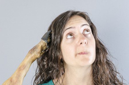 Woman thinking with ham leg in her head. Stupid situation.