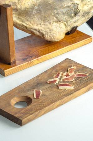 cured: Cured iberian ham leg, bellota ham. Gourmet spanish food.