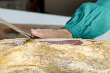 serrano: Slicing Spanish jamon iberico (serrano ham)