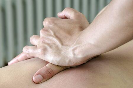 osteopathy: Physitoterapist  chiroprator doing a back massage. Osteopathy. Stock Photo