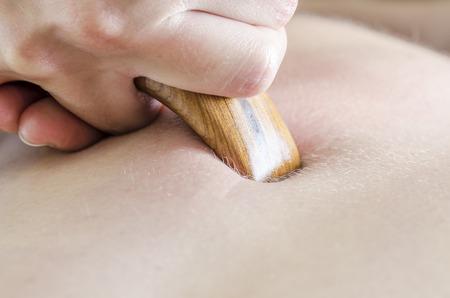 Physitoterapist  chiroprator doing a back massage. Osteopathy. Stock Photo