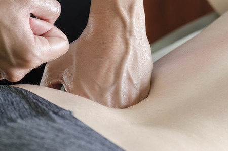 postural integration: Physitoterapist  chiroprator doing a back massage. Osteopathy. Stock Photo