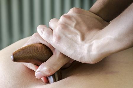 Physitoterapist  chiroprator doing a back massage. Osteopathy. Banco de Imagens