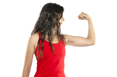 muscularity: Strong woman. Young woman showing her muscularity while isolated on white.