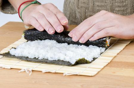 californian: Woman is making rolls in her kitchen.