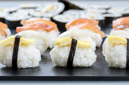 Sushi nigiri set on slate plate, close-up. Stock Photo