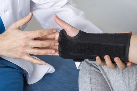 Patient is wearing a black wristband. Pain wrist.