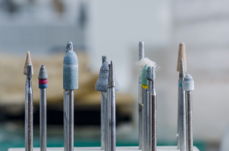 Tools of a dental technician, dental burs in a laboratory.