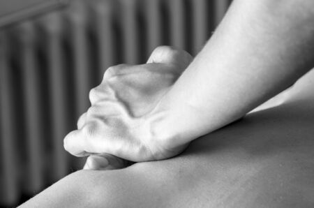 posture correction: Physitoterapist  chiroprator doing a back massage. Osteopathy. Stock Photo