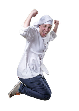Nice young woman chef is jumping. She feel really happy.