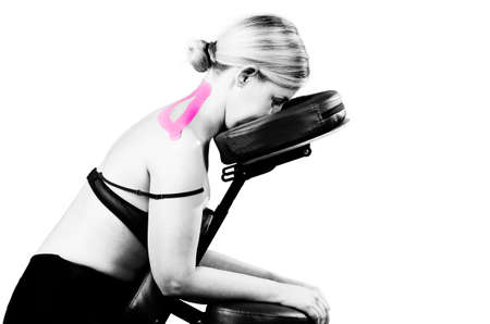 Kinesiotaping. Physical therapist applying tape to patient cervical in silhouette studio on white background. Stock Photo