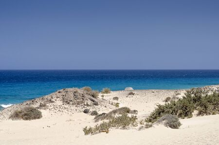 Sand dune and beach in the Natural-park, Corralejo , Fuerteventura, Canary Islands, Spain. Stock Photo